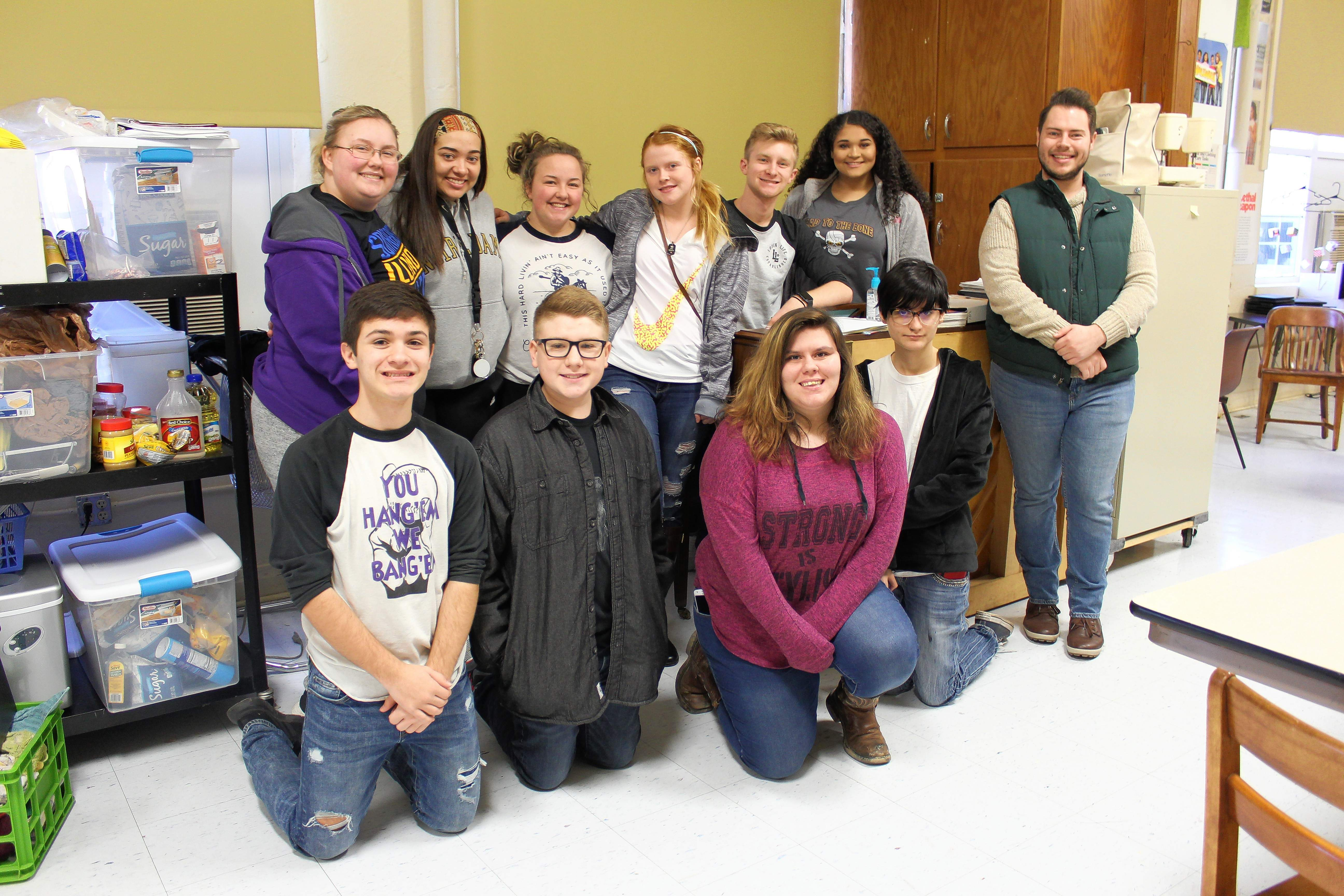 Carrier Mills-Stonefort High School students who attended were (kneeling,from left) Mason Kalodner, Colton Rice, Hallee Fitzgerald, and Rachel Sturgess, and (standing) Alex Morris, Jillian Crisp, Sami Morris, Arista Benton, Kale Rister, Lily Crisp, and CMSF music teacher and choir director Caleb Long.