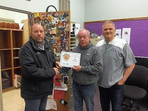 Harrisburg Unit 3 Maintenance Director Tony Chrismas, center, recently was recognized for his work for the school district. From left are  Andy Sisulak, Director of Marketing with Baysinger Architects, Chrisman, and Harrisburg Community Unit 3 School and Unit 3 Superintendent Mike Gauch.