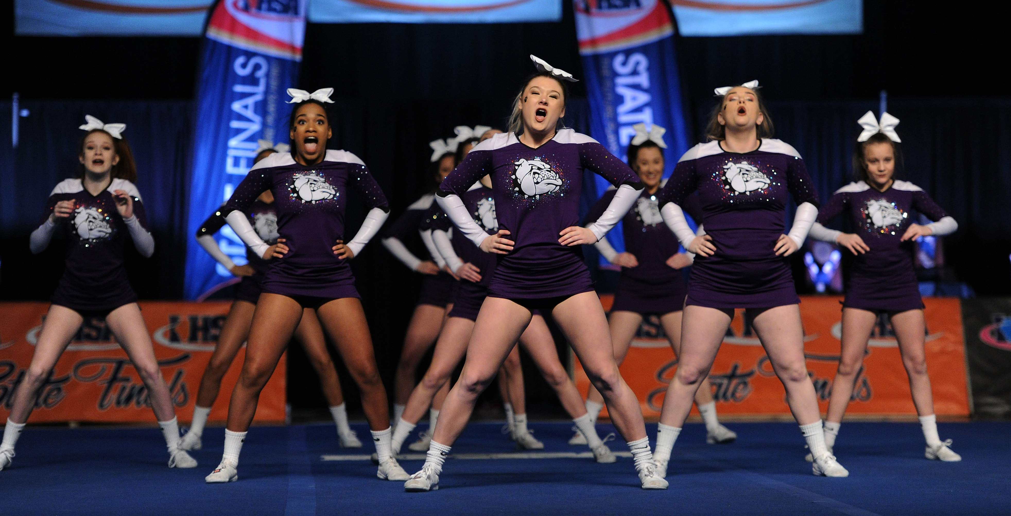Harrisburg small team division of the girls state cheerleading prelims do their routine in Bloomington on Friday.
