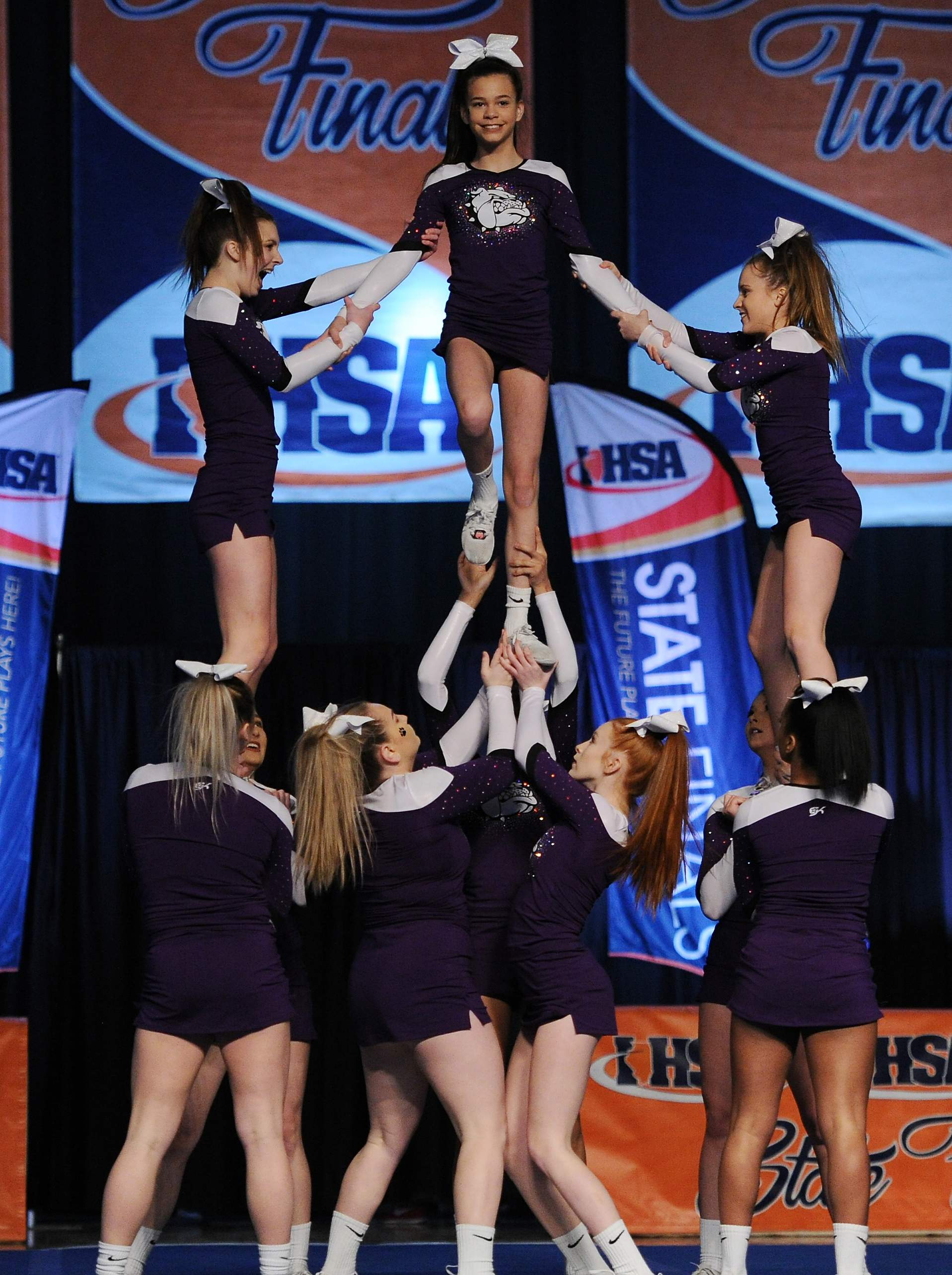 Harrisburg small team division of the girls state cheerleading prelims do their routine in Bloomington on Friday. See the full story on page 6.
