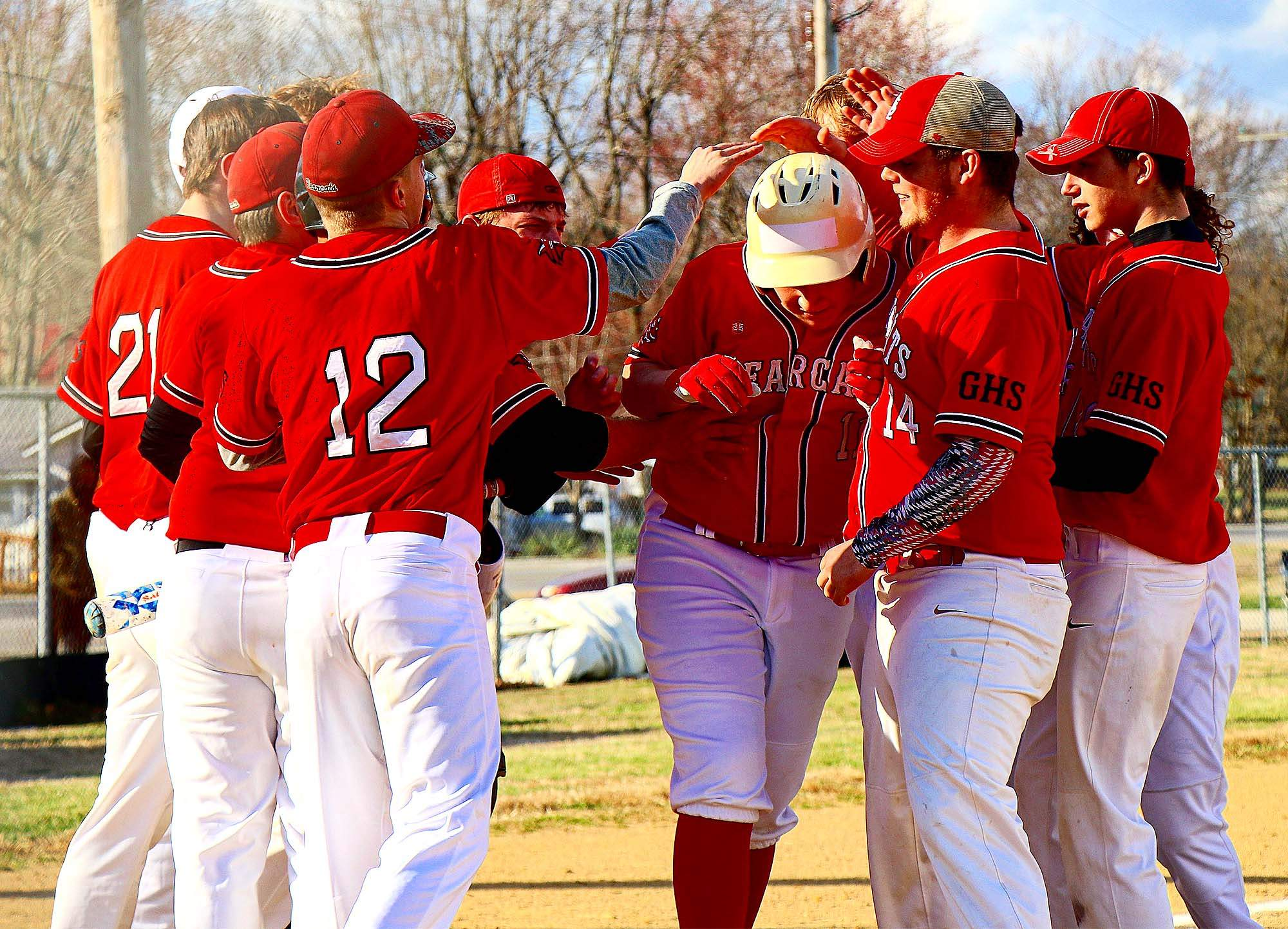 Klayton Wright is mobbed by teammates after Wright hit a home run against Johnston City in the home opener Friday at Galatia High School.