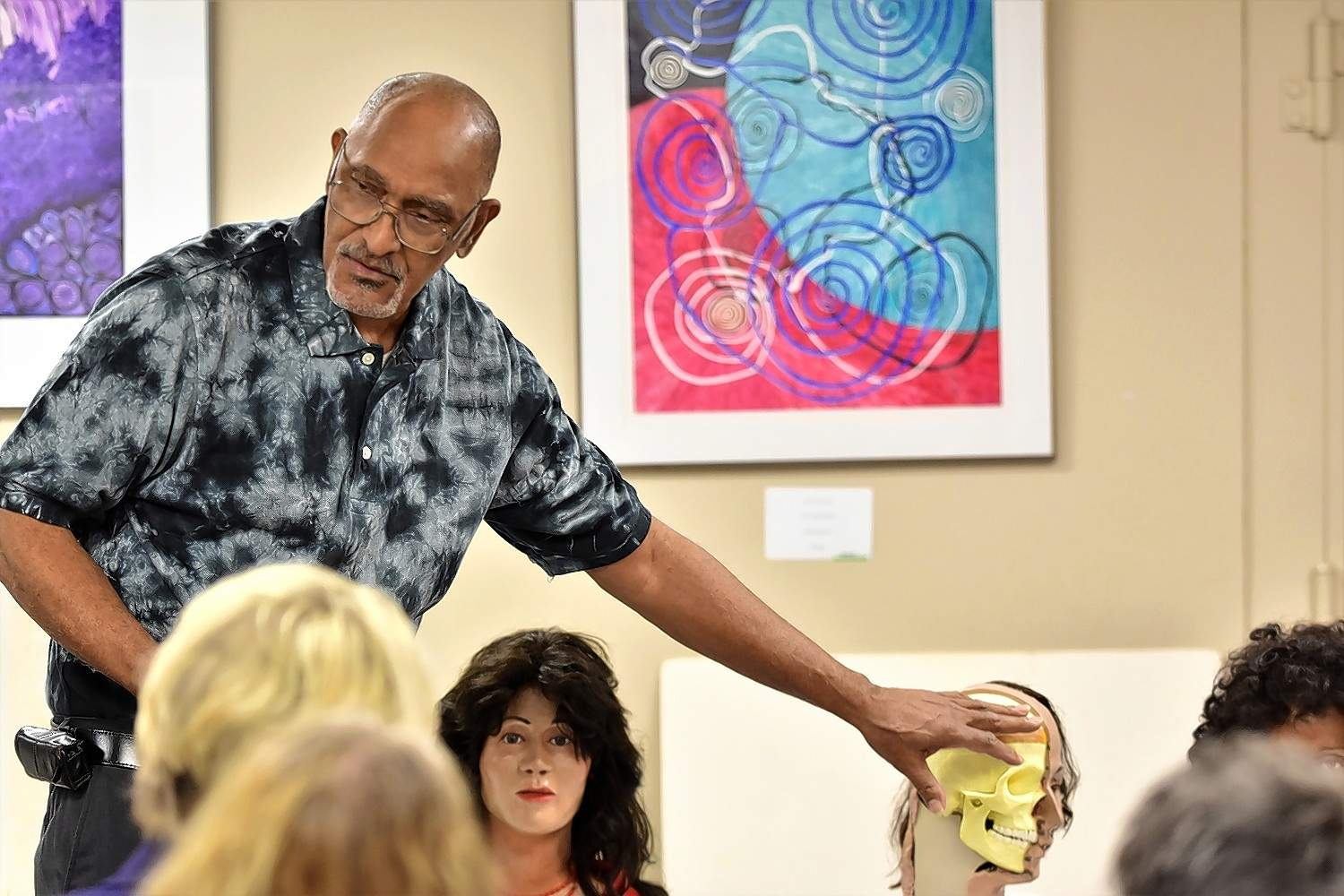 Former Elgin Police Department sketch artist Jesse Rouse explains how clay is used for facial reconstructions in some homicide cases at the Crime Lovers Book Club Monday at Harrisburg District Library.