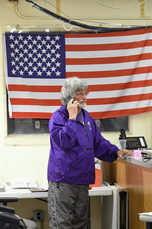 Roger Angelly, one of four new Harrisburg City Council members elected Tuesday, speaks on a cellphone in the Saline County Elections Office after all precincts were counted Tuesday night.