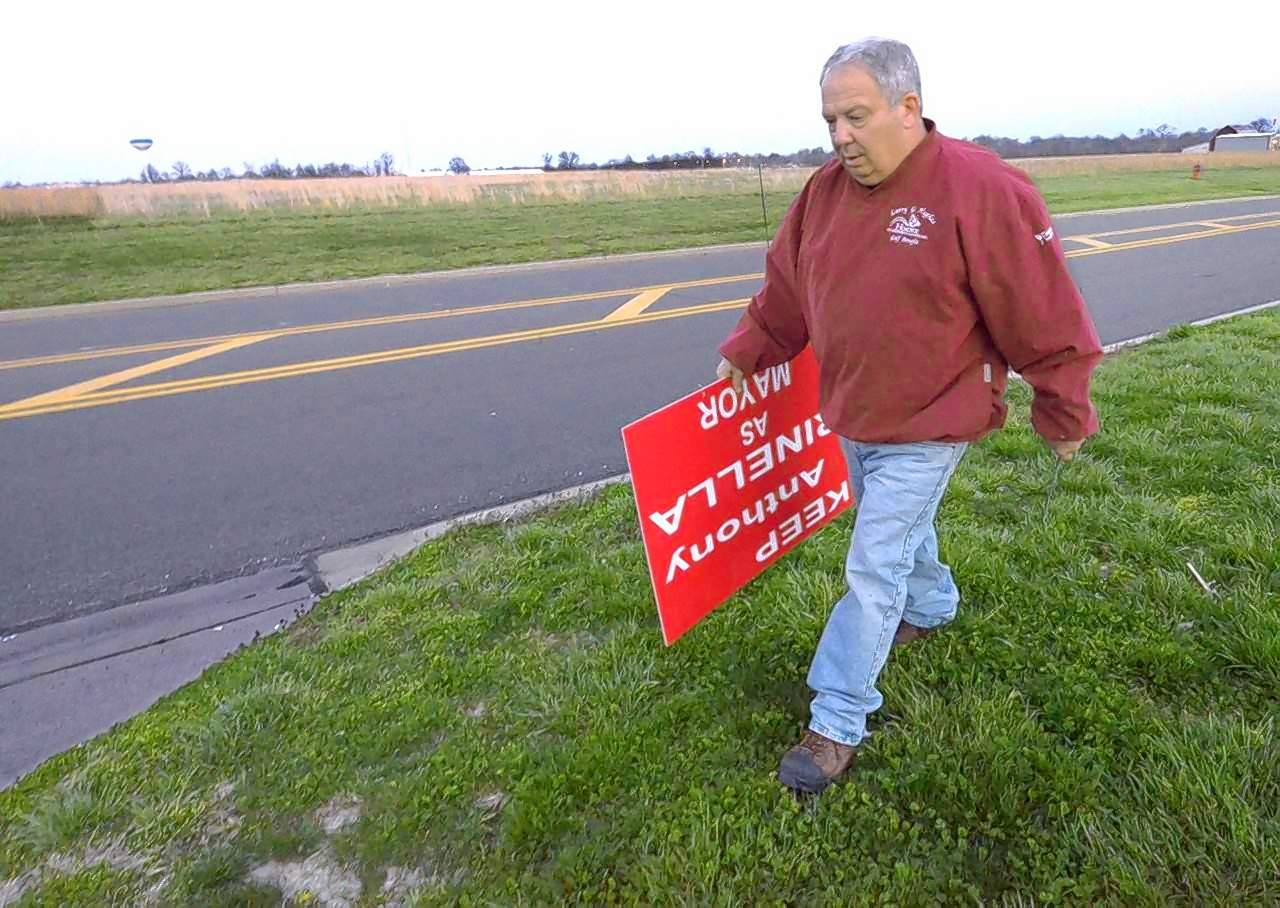 Marion's outgoing mayor, Anthony Rinella, drove around town Tuesday evening retrieving his campaign signs. Rinella said that he placed all of them, over 100, himself. Here he picks one up alongside Bainbridge Road on Marion's far west side.