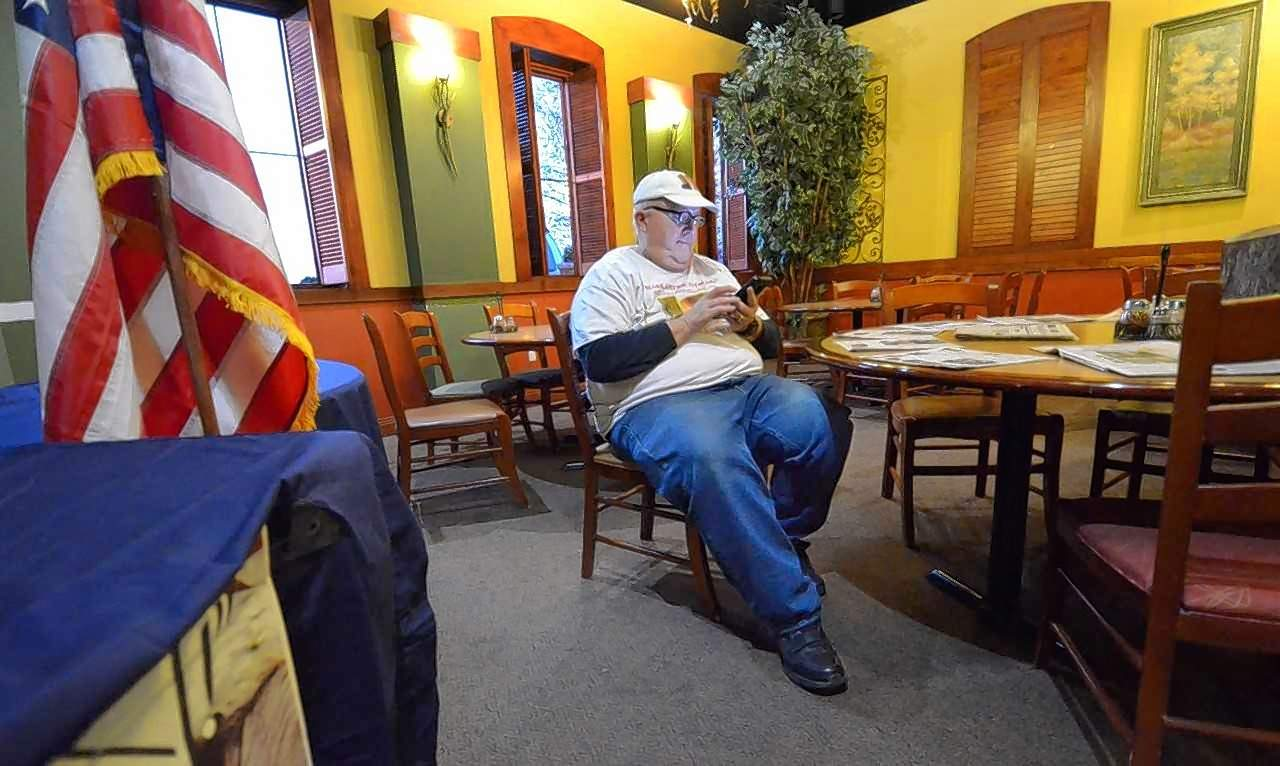 Marion mayoral candidate Dennis Ball sat checking his cellphone for incoming election results Tuesday night at Mackie's Pizza as he and three other candidates sought the office.