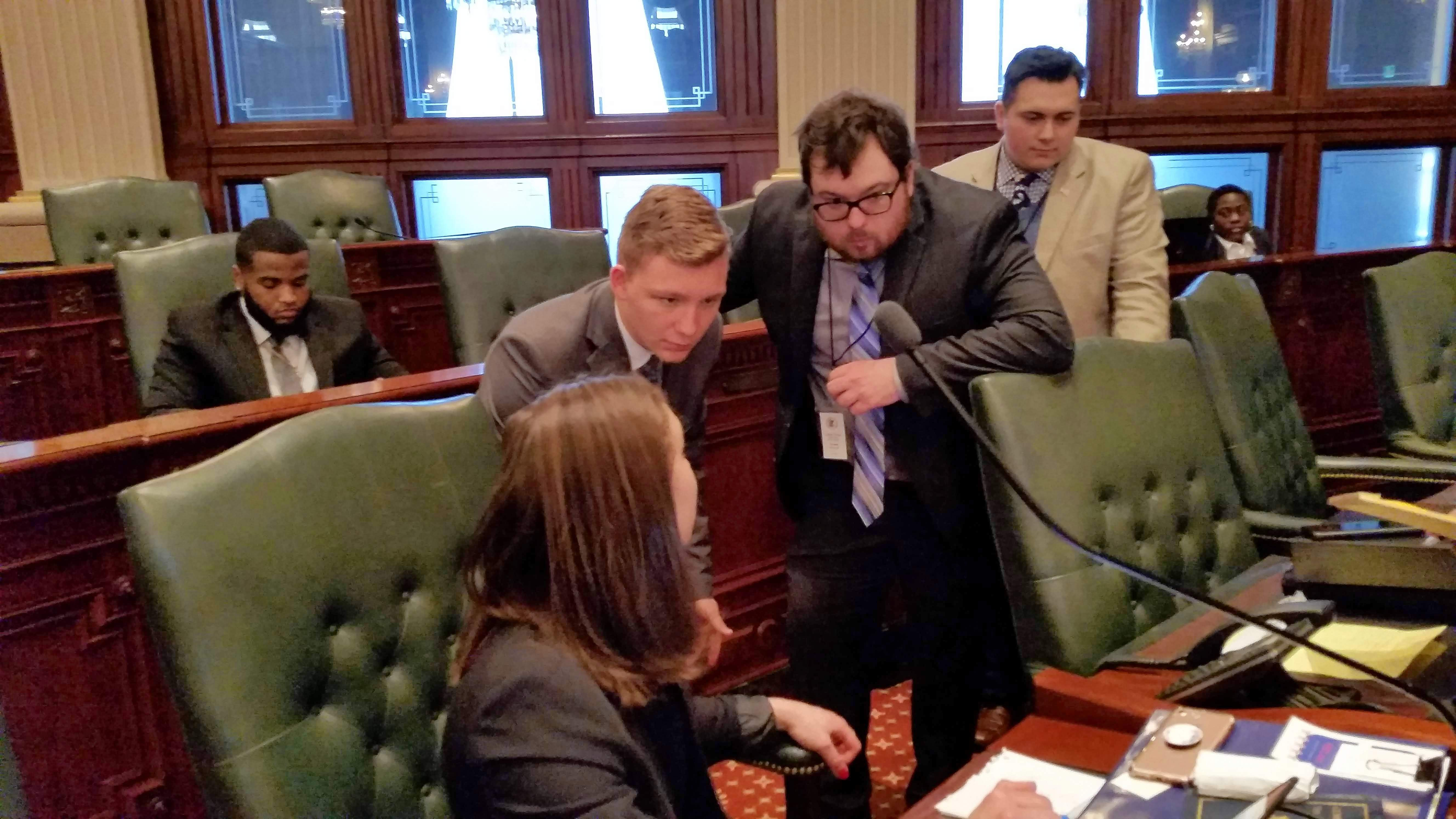 Assistant house majority leader Caleb Weiss (third from left) and whip Christian Lane (second from left) caucusing with leadership on the House Floor.