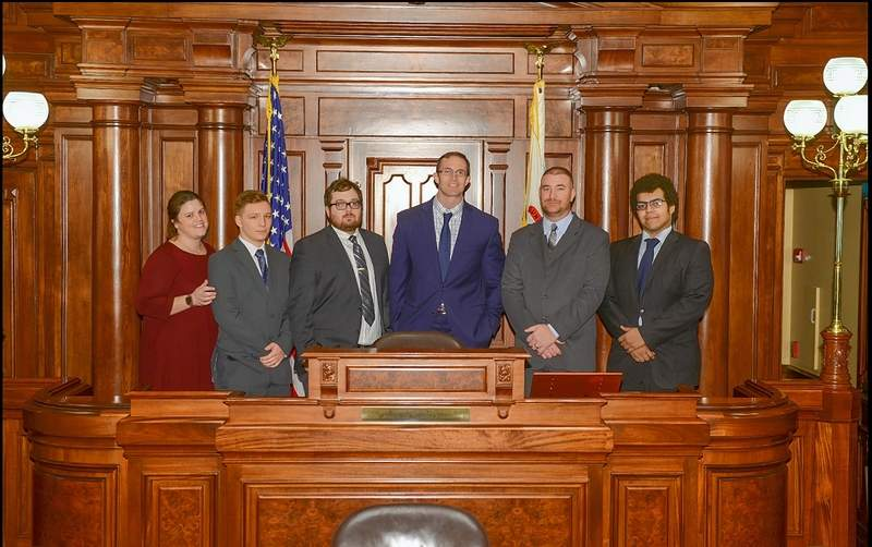 SIC's Model Illinois Government Team visits the Well of the Senate.   From left are head delegate Tracy Stokich (Galatia), Christian Lane (Rosiclare), Caleb Weiss (Enfield), advisor Matt Lees, Sean Dillard (Harrisburg), and second-year delegate Jordan Franks (Rosiclare.)