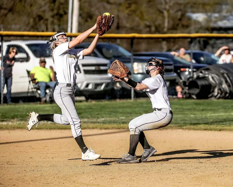 The Eldorado duo of Cydnee VanZant (left) and Paige Munds go after a popup in the Eagles' game against Edwards County earlier this week.