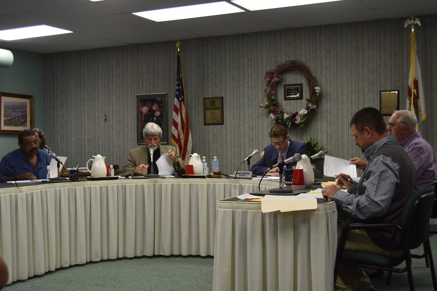 From left, Harrisburg's new city council are Raymond Johnson, Roger Angelly, Mayor John McPeek, Ron Morse and Raymond Gunning (at right end of table).