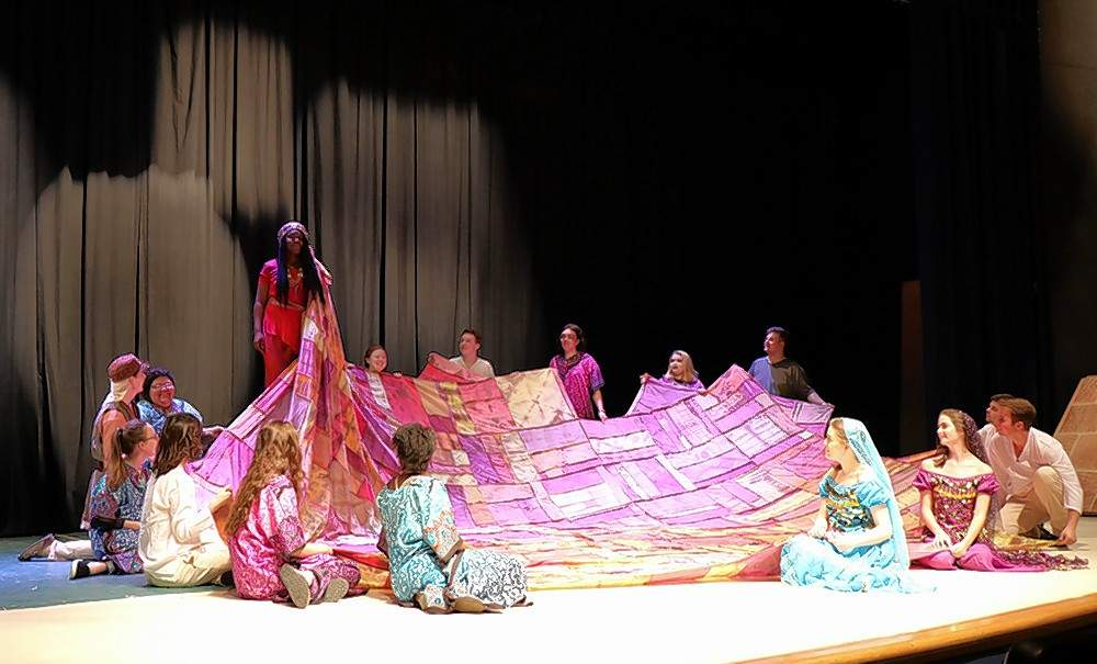 Aida (Sena Ntumy of Carbondale) dons a robe made of the clothes of Nubian slaves during a scene from Aida. The show will hit the SIC Kimball Stage April 26-28.