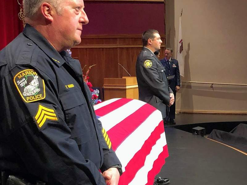 Marion Detective T.J. Warren (foreground) and Aaron Pritchett form an honor guard next to Mayor Emeritus Bob Butler's casket just before the doors opened to the public for a Tuesday funeral service at the Marion Cultural and Civic Center.