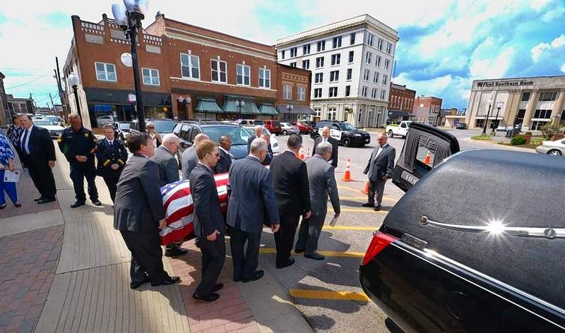 Pallbearers Caleb Butler, Dick Butler, Andrew Carruthers, Gary Carruthers, Brian Fisher, Terance Henry, Anthony Rinella and Carl Stewart carried the body of the late longtime Marion Mayor Robert Butler from the Marion Cultural & Civic Center to the awaiting hearse.