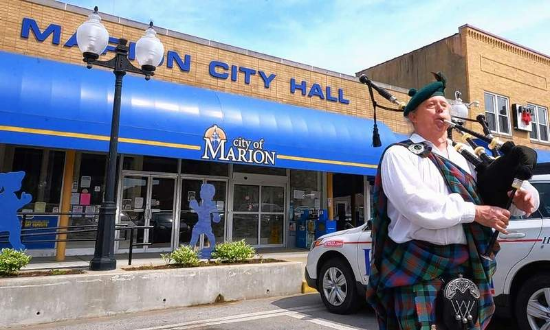 Pipe Major Les Lannom of Johnston City plays as the hearse carrying the body of the late longtime Marion Mayor Robert Butler makes its way around Tower Square twice before heading for private internment services.