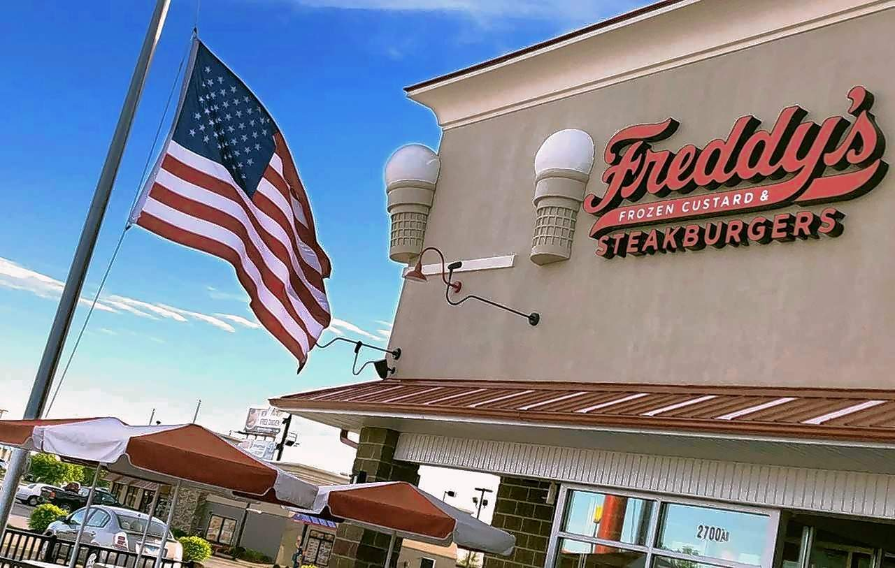 "Old Glory is flying at half staff at Freddy's Frozen Custard & Steakburgers Tuesda, one of many Marion businesses that paid tribute to the late longtime Mayor Robert ""Bob"" Butler, the longest serving mayor in the history of Illinois."