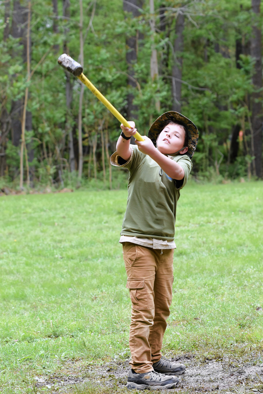 Logan Grathler of Harrisburg Troop 23 competes in hammer toss.