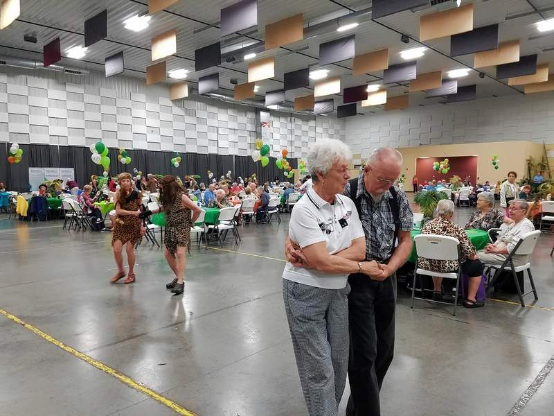 Loving couple Diana Andrews and Daryl Meier, both of Carbondale, kick up their heels on the dance floor at Wednesday's Senior Fun Fest at the Marion City Pavilion.