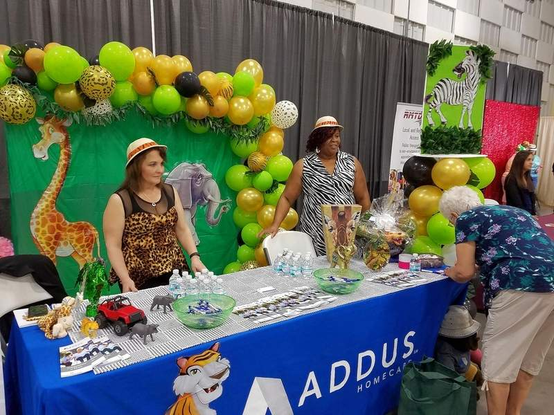 Amber Boyd (left) and Michelle Hackney, employees with Addus Home Care in Marion, interacted with dozens of seniors at Wednesday's Fun Fest. Addus provides personal care and homemaker services.