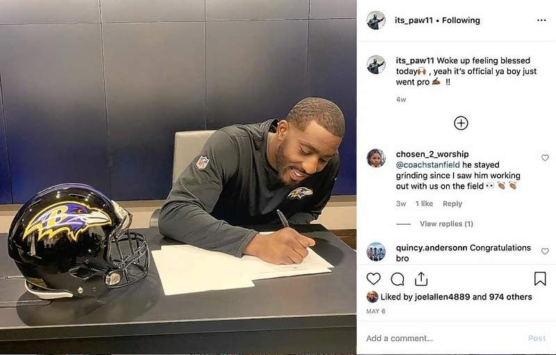 Marion High School graduate Aaron Adeoye fills out some paperwork recently to become a free agent with the Baltimore Ravens of the NFL. Adeoye was better known as a basketball player in high school and college, but emerged late in his collegiate career as a defensive end prospect.