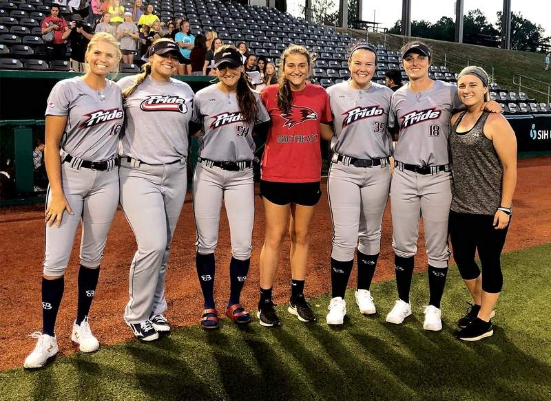 Harrisburg's Karsyn Davis (center) spent this past weekend as a bullpen catcher for the USSSA  Pride, who spent the weekend playing the Canadian Wild at Rent One Park in Marion.