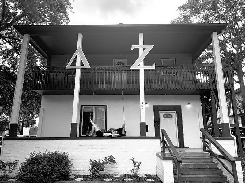 Bike & Build members relax on the porch of the Delta Zeta sorority house in Carbondale.