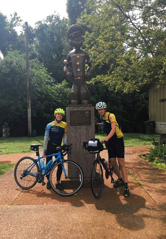 Bike & Build team members pause for a photo with the Popeye statue at Chester before departing to Missouri.