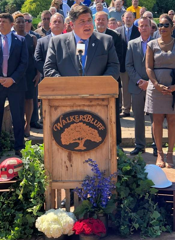 "Gov. J.B. Pritzker tells those gathered at Walker's Bluff on Tuesday that it took a bipartisan effort in ""the best tradition of democracy"" to pass both the gaming bill and Rebuild Illinois."