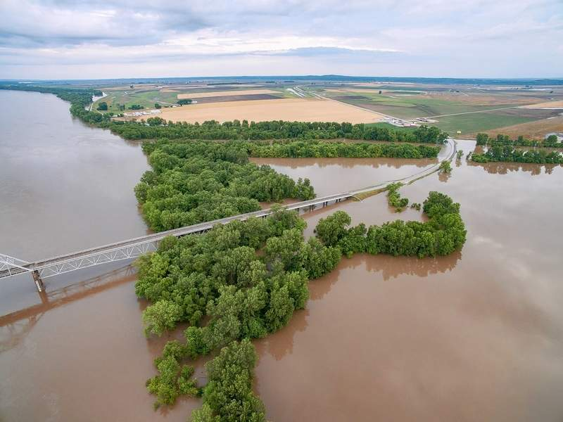 In June, the Chester Bridge and Highway 51 disappear into the Mississippi River approaching McBride, Missouri.