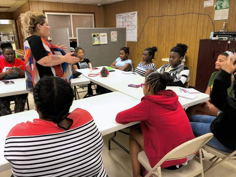 Johnston City business owner Kelly Kendrick-Tyson conducts a meditation and journaling session following a skin-care class for adolescent girls and their moms at the Boyton Street Community Center in Marion.