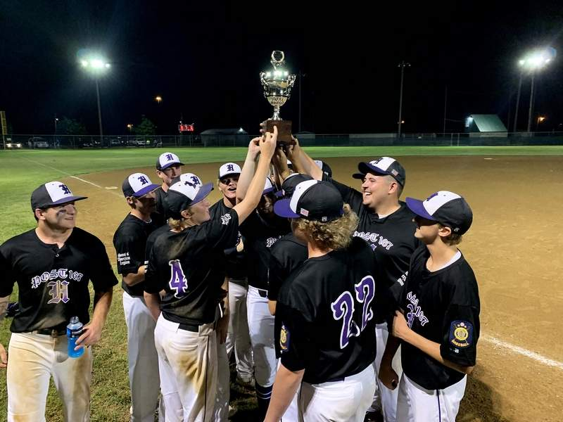 Members of the Harrisburg Sons of American Legion Post 167 baseball team pose with the championship trophy after winning the 24th District Tournament Wednesday night, knocking off Fairfield 8-6 in the championship game.