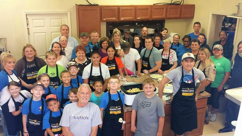 Volunteers gather for a photo in the kitchen at a recent evening at Heaven's Kitchen in Harrisburg.
