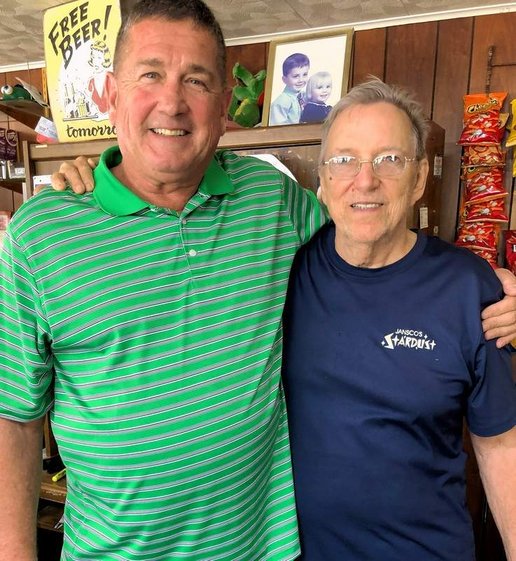 Mike Bush, left, of Marion, pauses for a photo with Dave McNeal before playing a round at Jansco's Stardust on Wednesday afternoon.  Bush was hoping to duplicate last weekend's feat when he shot a hole-in-one on number seven, the third of his career.