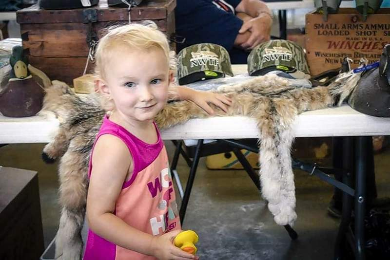 Elsa Stewart, 2, of Hurst, posed for a picture while observing the many booths on display at the Southern Illinois Sportsmans Show Saturday in the Exhibition Hall at the Du Quoin State Fairgrounds.
