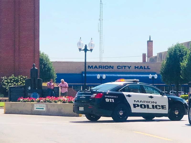 Marion Police were on the scene near City Hall Monday morning after a suspicious package was found in a newspaper box.