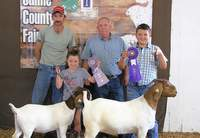 2019 4-H Breeding Commercial Meat Goat Grand Champion and Reserve Champion, Gavin Horton, is pictured with judge Tim Quiggins following the show.