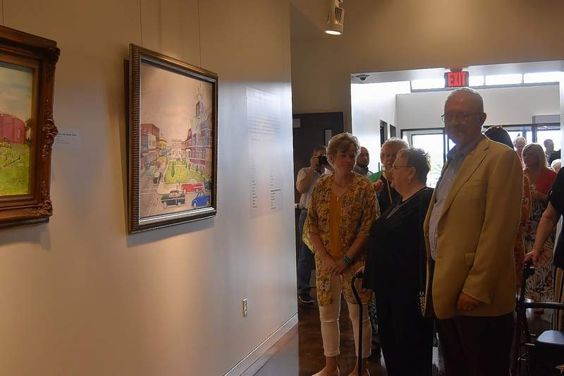 Joe and Mary Sue Ewing of Harrisburg take in works by artist Jesse Rouse of Harrisburg.