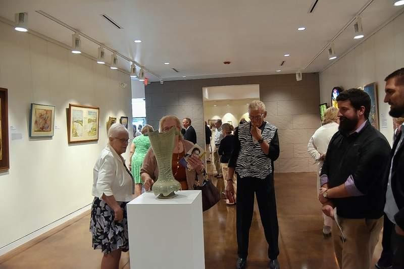 Visitors view a sculpture at the Ella Elizabeth Hise Museum of Regional Art Friday.