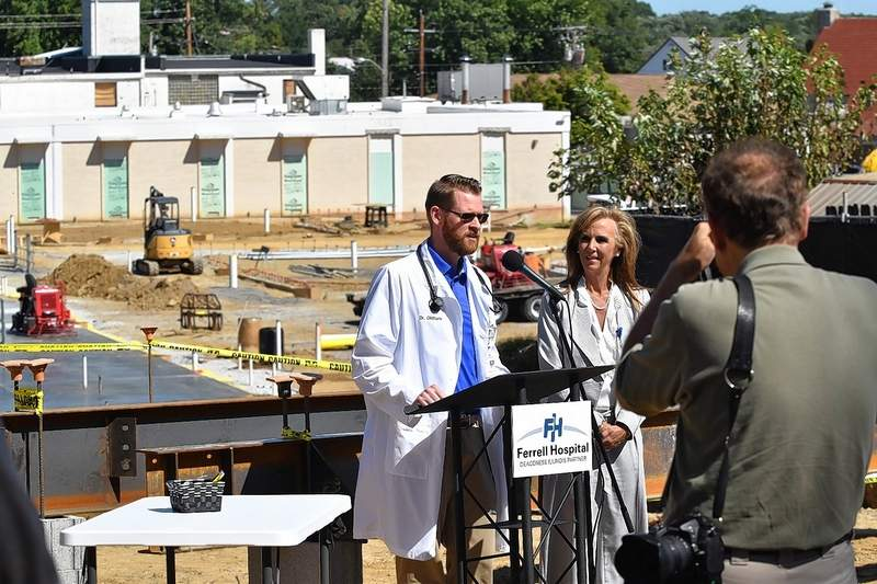 Dr. Nate Oldham and Ferrell Hospital CEO Alisa Coleman speak in front of the site of the hospital's expansion Wednesday afternoon.