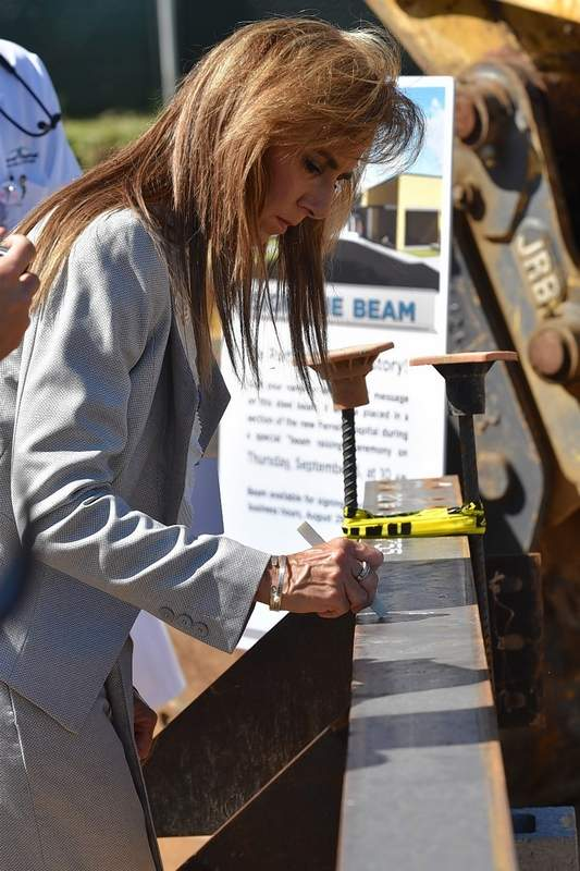 Ferrell Hospital CEO Alisa Coleman signs the main beam for the hospital's expansion project Wednesday afternoon.