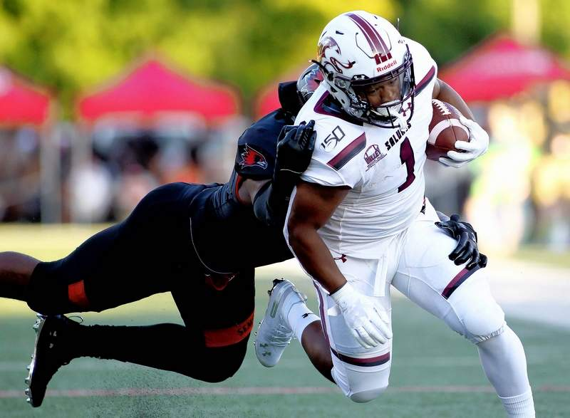 Romeir Elliott (1) a freshman running back for SIU, moves upfield past a Southeast Missouri State defender Thursday night at Houck Stadium in Cape Girardeau, Mo. Elliott had 39 yards on nine carries in the Salukis' 44-26 loss.