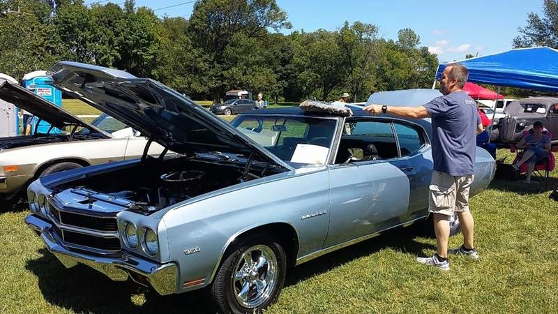 Benny Davis of Anna dusts his 1970 Chevrolet Chevelle Malibu Monday at the Memory Lane Car Show.