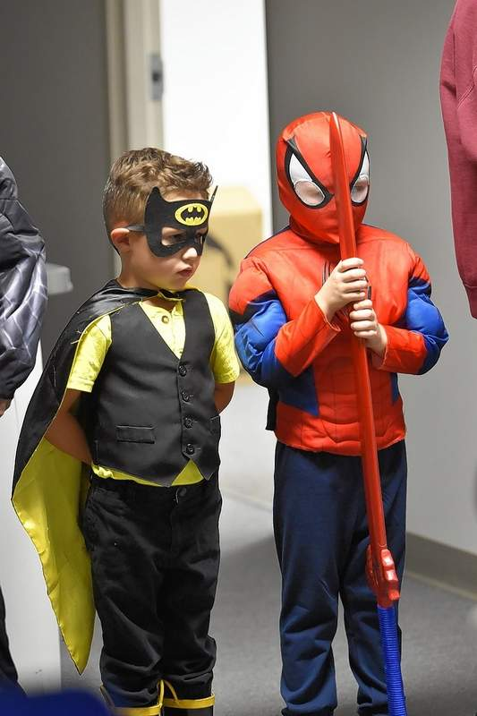 A very young Batman and Spider-Man wait for judging to begin at the Burg Comics Con cosplay contest Saturday in Harrisburg.