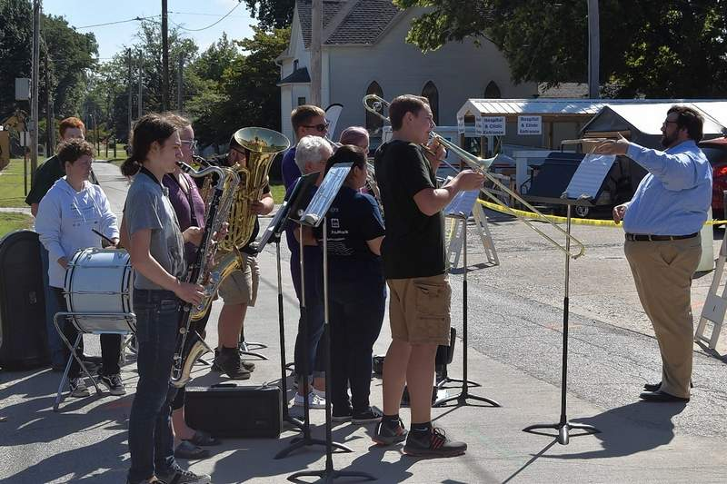 Eldorado High School Band Director Storm Santos, right, conducts members of the Eldorado High School Band as they play Thursday morning at Ferrell Hospital's beam-raising ceremony.