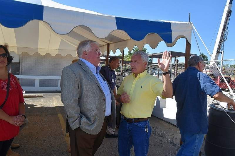 Eldorado Mayor Rocky James, right, talks to Ferrell Hospital expansion project architect David Johnson following the raising of the main beam of the expansion Thursday morning.