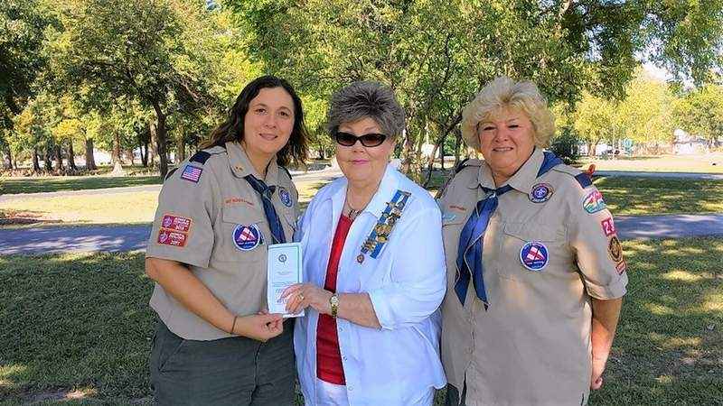 DAR Regent Sharon Tanner, center, gives leaflets about flag etiquette to Harrisburg Cub Scout leaders Laura Spanel, left, and Susie Lampley, right, to share with their Scouts.