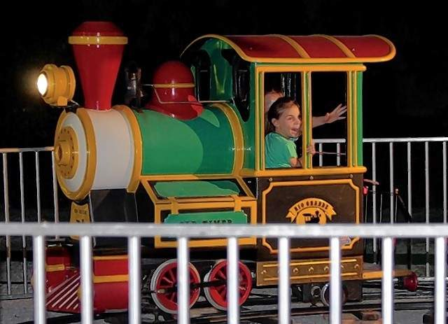 A little girl enjoys a train ride Friday night.