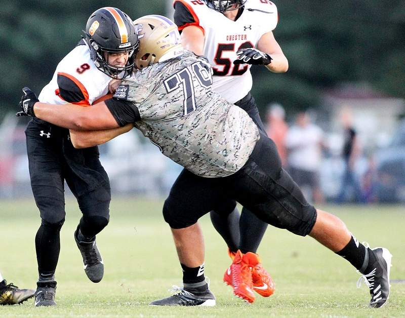 Eldorado's Creed Justice tackles Chester D. Kelkhoff in the first half Friday at Boz Adams Field.