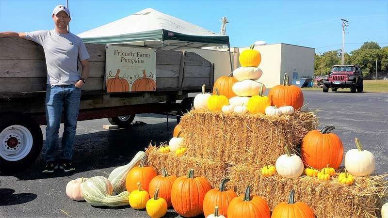 Mike Respondek, of Friendly Farms Pumpkins, stands next to one of his displays in Parker Plaza.