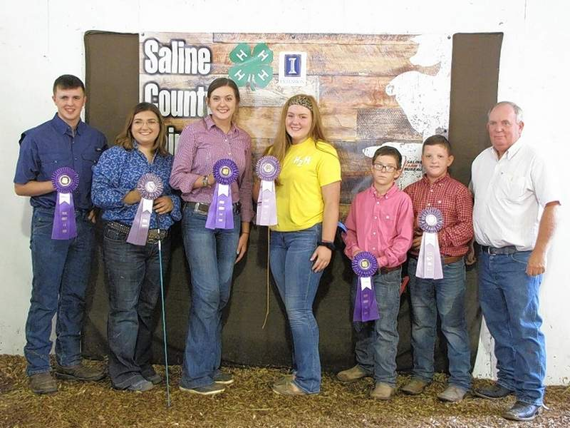 PHOTO COURTESY OF NANCY LAMBERT2019 4-H Swine Showmanship Champions and Reserve Champions are pictured following the Saline Co. 4-H Swine Show held in July.  From left are:  Senior Grand Champion, Joel Glenn, Senior Reserve Champion, Taylor Hale, Intermediate Grand Champion, Kate Bond, Intermediate Reserve Champion, Ali Joyner, Junior Grand Champion, Karson Baird, Junior Reserve Champion, Cayden Baird, and judge Tim Quiggins.