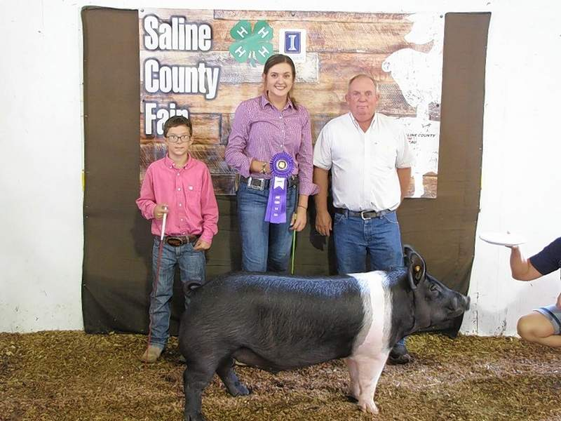 PHOTO COURTESY OF NANCY LAMBERT2019 4-H Purebred Market Swine Grand Champion, Kate Bond.