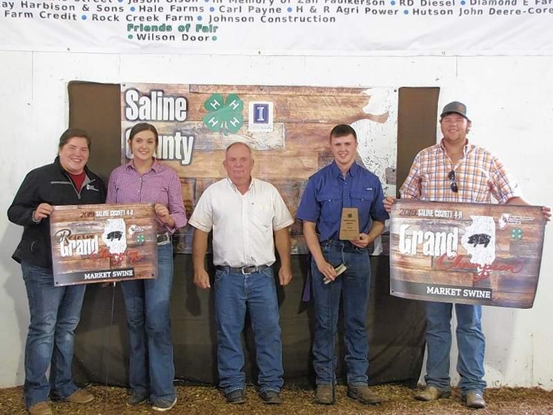 PHOTO COURTESY OF NANCY LAMBERT2019 Overall Market Swine Champion, Joel Glenn and Reserve Champion, Kate Bond.